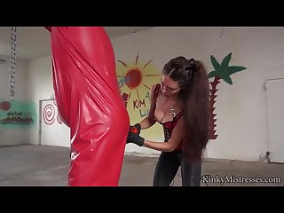Susis slave in red rubber