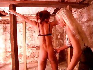 Fantastic blonde milf spanks stunning redhead whore
