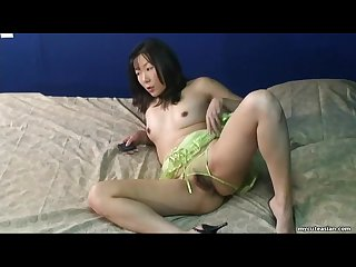 Asian bitch rubbing her wet pussy down so she cums