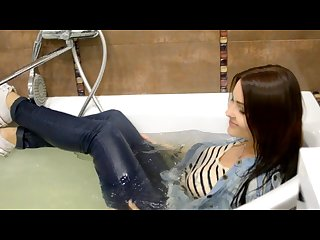 Wetlooker nastya takes a bath in her jeans