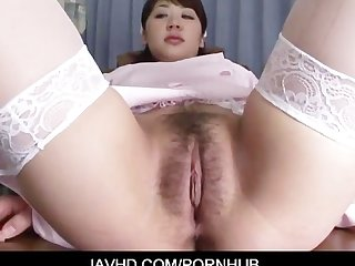 Horny japanese chick in nurse uniform shows off her hairy pussy