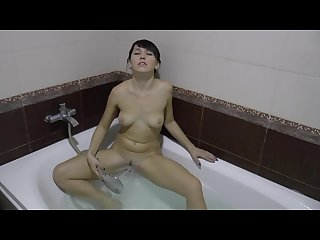 Girl with a water jet and orgasm