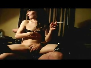 Wife smokes with a cock up her ass and masturbates her tight pussy