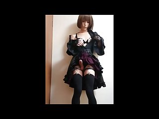 Japanese shemale in goth dress playing