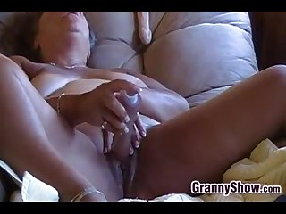 Horny granny masturbating with her toys
