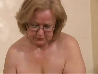 Gorgeous mature slut jerking young cock amateur older