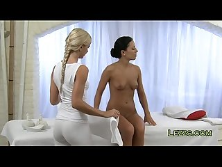 Blonde masseuse oils tanned brunette