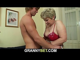Hot looking guy bangs old grandma on the couch