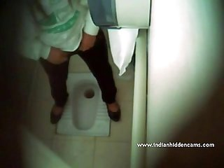 Indian Babe Filmed Naked In Public Toilet - IndianHiddenCams.com