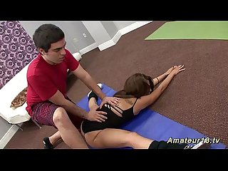 Teen gymnast gets stretched by her trainer