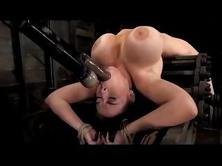 Girl with huge tits tied to machinge getting fingered whipped fucked with toys in the dungeon