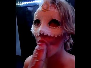 Masked milf gives a blowjob