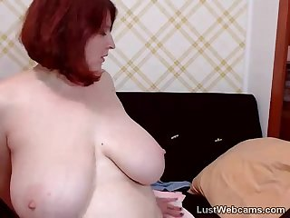 Busty redhead milf masturbates on webcam