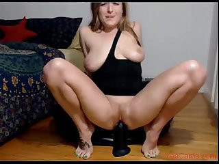 Hot wife rides big black dildo and squirts in kitchen on cam