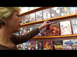 Granny fucks a guy in the video store