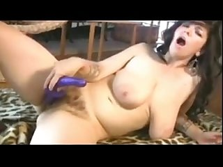 Hairy girl masturbating with a purple toy