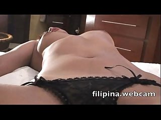 Filipina webcam sex chat girl in hotel strips nude fingers wet hairy pussy