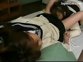 Schoolgirl in uniform tied to bed kissing licking pussy on the bed in the dormitory
