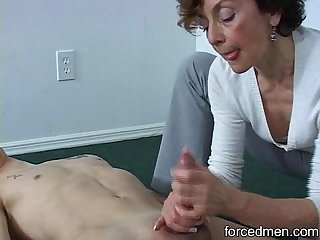 Oldie mistress is able to extract young man\'s cum