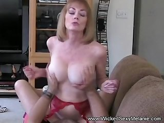 Mom riding son S cock on the couch