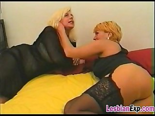 Mature lesbians toying and satisfying their wet pussies on the couch